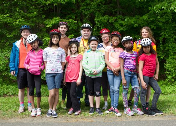 Volunteers from Elm City Cycling with girls from the Farnham Neighborhood House